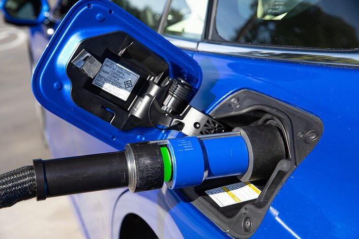 Photo of Toyota Mirai hydrogen fuel cell car being refueled to illustrate blog post about ammonia as a fuel and as a way to distribute hydrogen as a fuel