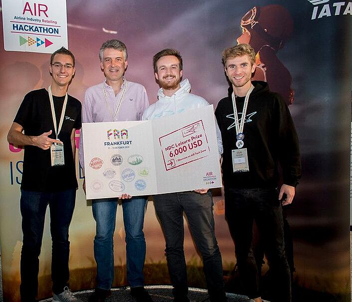 Photo to illustrate blog post about Cloverly team and API being featured at International Air Transport Association hackathon in Frankfurt, Germany, to help offset carbon emissions from air travel, showing winners of one category who used Cloverly to make air travel more carbon-neutral