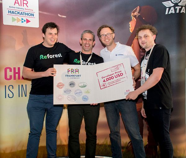 Photo to illustrate blog post about Cloverly team and API being featured at International Air Transport Association hackathon in Frankfurt, Germany, to help offset carbon emissions from air travel, showing winners of one category