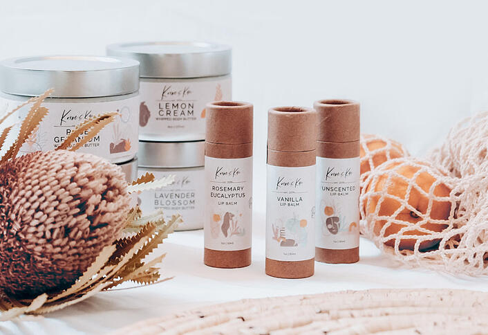 Photo of lip balm and other products to illustrate blog post about Cloverly partner Koree's Kare, which uses Cloverly to offset the carbon costs of ecommerce shipping with carbon offsets