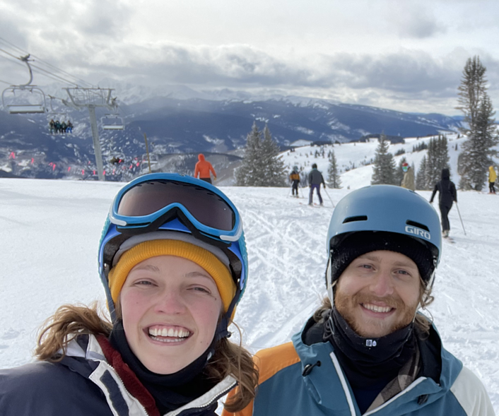 Photo of Reagan Cline and Ben Weinberg on Colorado ski slope to illustrate story about their using carbon offsets from Cloverly to neutralize the carbon impact of their road trip