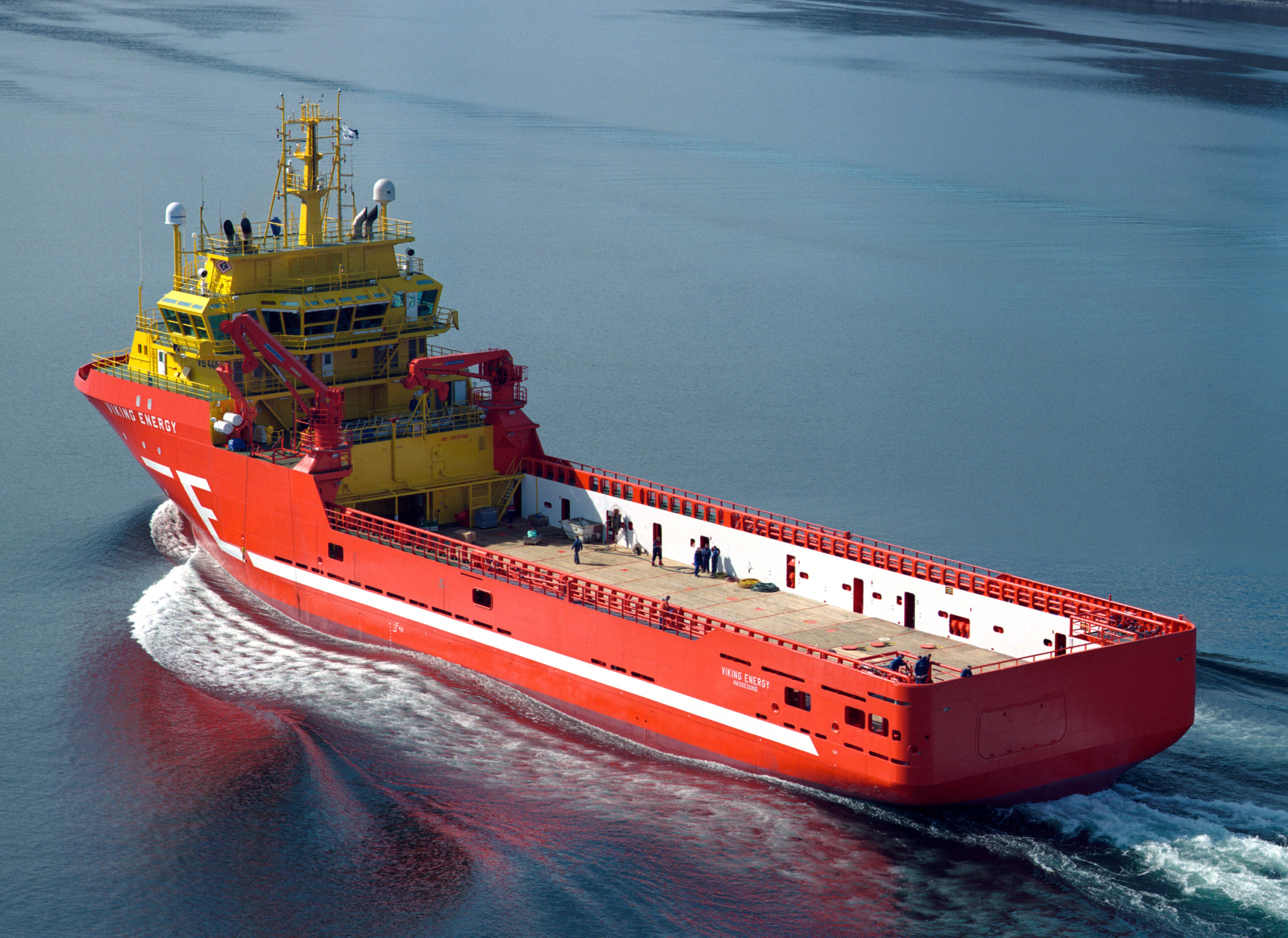 Aerial photo of red supply ship called Viking Energy underway at sea, to illustrate Cloverly post about using ammonia as a carbon-free fuel